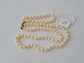 A string of pearls with silver gilt clasp