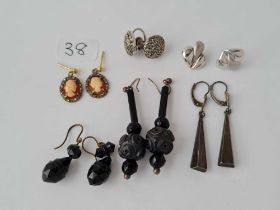 Four pairs of silver and other earrings