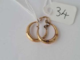 A small pair of 9ct hoop earrings 1g