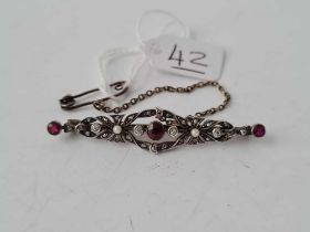 A Victorian ruby and diamond and pearl brooch set in silver and gold