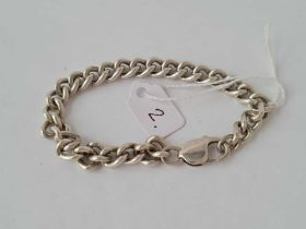 A silver curb link bracelet - 29.5 gms