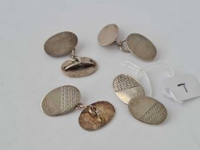 Two pairs of oval silver cufflinks