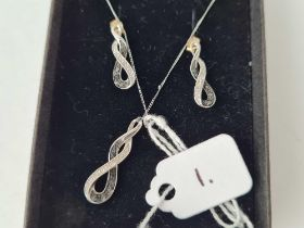 A suite of white gold pendant and earrings black and white diamonds 9ct