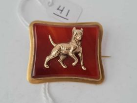 A Victorian cornelian agate and gold dog brooch