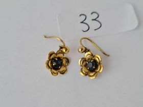 A pair of 9ct stone set flowerhead earrings