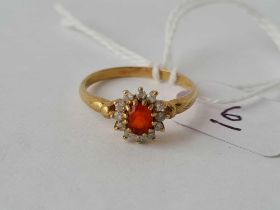 A 9ct red stone cluster ring size O