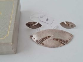 A unusual arts and crafts brooch together with matching earrings by Diane Cross