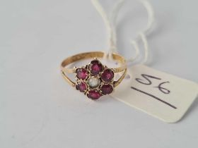 A Victorian gold garnet cluster ring hallmarked for 1857 size K
