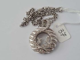 A STRIKING DIAMOND ENCRUSTED 18ct white gold pendant on 18ct chain 28.7g