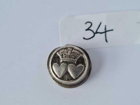An antique silver stud with double heart and crown motif marked T A