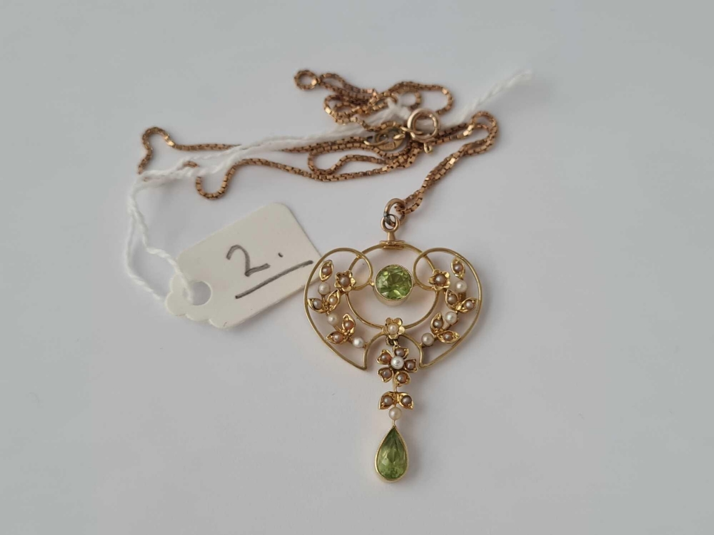 A art Nouveau and pearl and peridot pendant 15ct gold on 9ct neck chain
