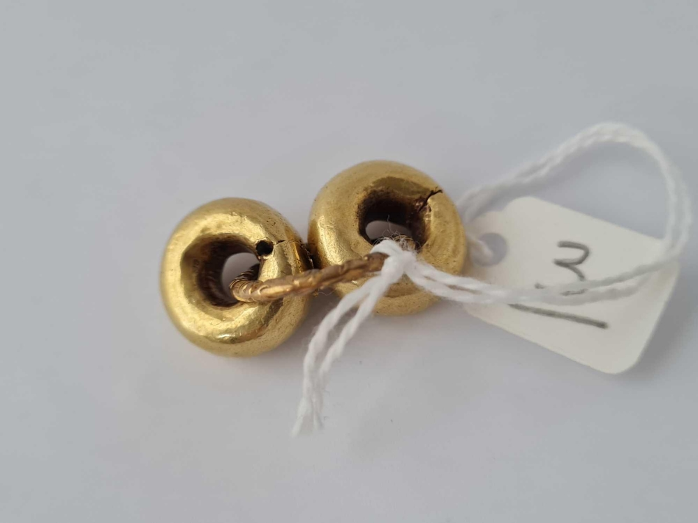 A antique split ring with chased decoration and two gold mounted circles with metal cores - Image 2 of 2