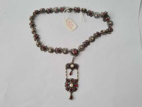 A 19TH CENTURY AUSTRO HUNGARIAN SILVER GARNET AND PEARL NECKLACE