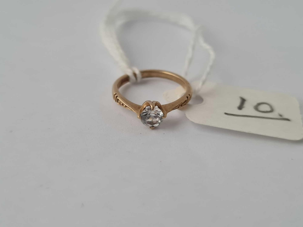 A tiny antique ring 9ct with single stone