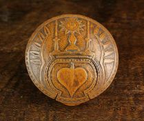 An Early 18th Century North European Boxwood Snuff Box of circular form.