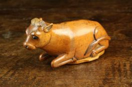 A Rare 19th Century Treen Snuff Box carved in the form of a Recumbent Cow with inset black bead