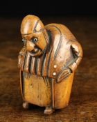 An Early 19th Century Carved Coquilla Nut Snuff Box in the form of grotesque hump backed man with