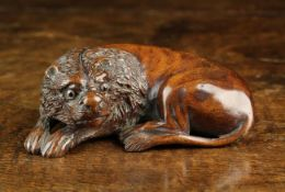A Fine 19th Century Carved Mahogany Snuff Box in the form of a recumbent Lion with glass inset eyes
