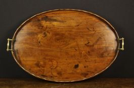 A Georgian Mahogany Bulter's Tray of oval form having a scalloped gallery and brass scroll handles