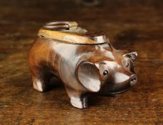 A Carved Lignum Snuff Box in the form of a Pig with inset bead eyes and lid to it's back fitted