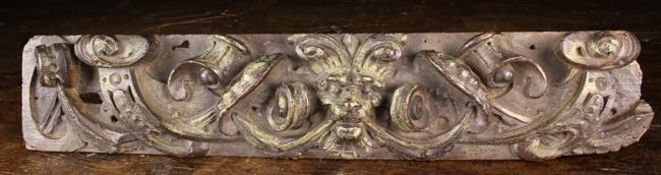 A 17th Century Oak Fragment Rail (A/F) relief carved with a mythical beast's face mask bearing