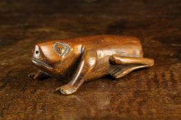 An Early 19th Century Fruitwood Snuff Box in the form of a Frog with gouge carved features and a