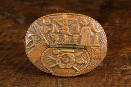 An Early 18th Century North European Oval Boxwood Snuff Box with a low releif carved scene of The