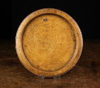 """An 18th Century Beechwood Platter with raised rim, stamped """"S I"""" on the reverse."""