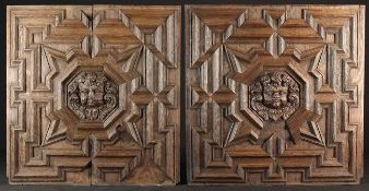 A Pair of 17th Century Oak Panels adorned with geometric moulding centred by carved cherubic face