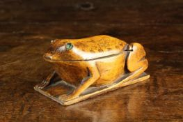An Early 19th Century Fruitwood Snuff Box carved in the form of a Frog.