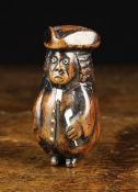 An 18th/19th Century Stained Walnut Snuff Box carved as a bewigged curmudgeonly gentleman with