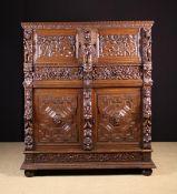 A Fine 17th Century Flemish Carved Oak Four-door Cupboard, Brugges, Circa 1630.