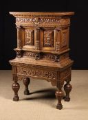 A Small 17th Century Flemish Carved Oak Cabinet on Stand.