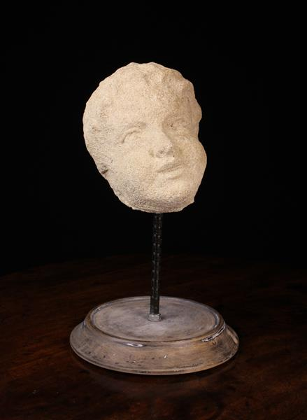 A Late 17th/Early 18th Century Carved Limestone Head of a Putto, mounted on a turned wooden base, - Image 2 of 2