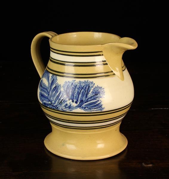 A Good, Mid 19th Century Mocha-ware Jug.
