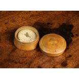 """A Small Pocket Compass in a 19th Century Turned Wooden Case, 1¾"""" (4.5 cm) in diameter."""