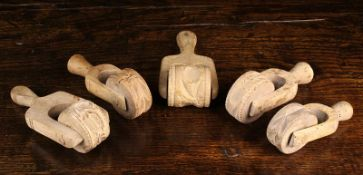 Five Antique Butter / Pastry Rollers carved with decorative moulds; floral sprigs,