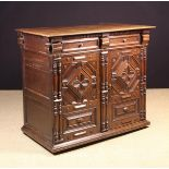 A Fine Charles II Oak Enclosed Chest of Drawers richly decorated with elaborate geometric mouldings,