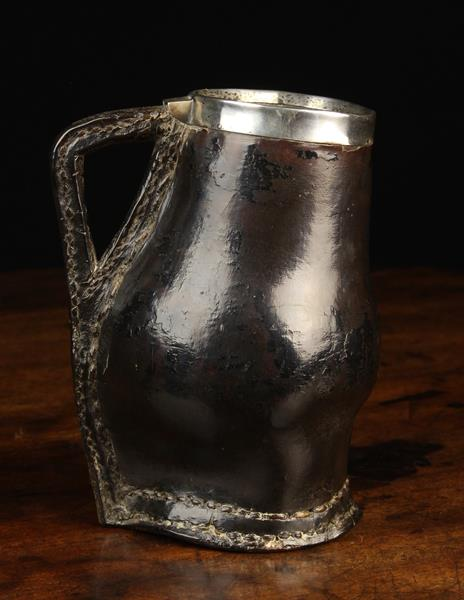 A Late 18th/Early 19th Century Leather Tankard of baluster form with a cut out triangular handle, - Image 2 of 3