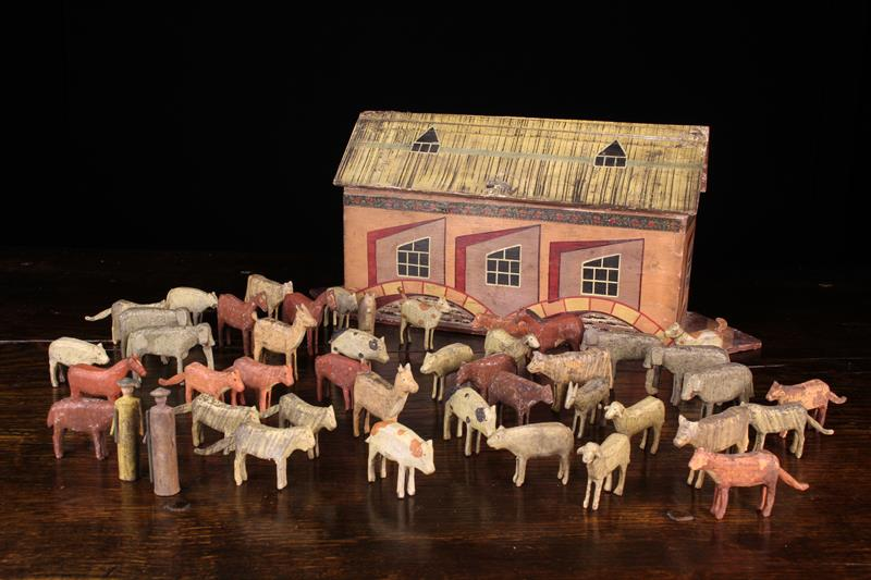 A German Painted Wooden Toy Noah's Ark & Animals, Circa 1930, attributed to the Erzgebirge region.