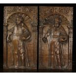 A Pair of 17th Century Oak Panels relief carved with Saints stood within arches and enriched with