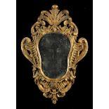 An 18th Century Carved Giltwood Girandole Mirror.