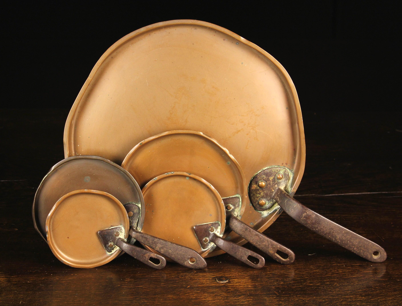 "Five 19th Century Copper Pan Lids with riveted handles, 12½"" (32 cm), 6¾"" (17 cm), 5¾"" (14."