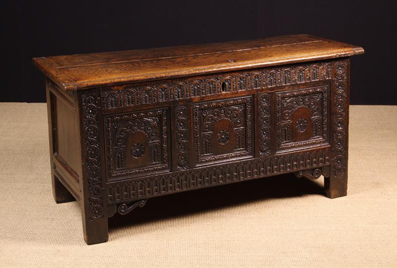 A Fine 17th Century Carved Oak Coffer of rich colour and patination.