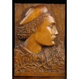 A Relief-Carved Fruitwood Panel depicting a profile head portrait inscribed to the base 'Gesi'.