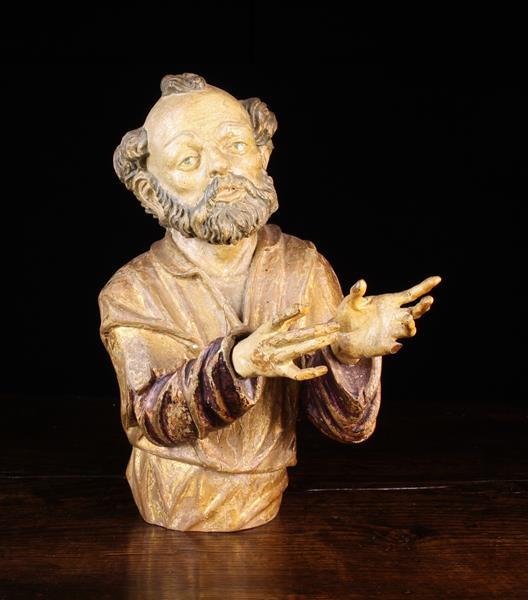 """A 16th/17th Century Polychromed Wood Carving: Bust of Saint Joseph 15½"""" (39 cm) in height."""