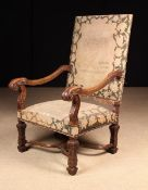 A Large Late 19th Century French Carved Walnut Fauteuil in the Louis XIV Style.