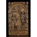 A Fine Early 17th Century Flanders Oak Arcaded Panel carved with 'The Annunciation'.