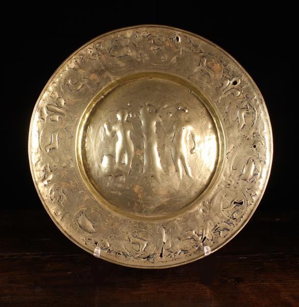 A Large 17th Century Repoussé Brass Alm Dish (A/F). - Image 2 of 2