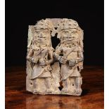 A 16th Century Benin Bronze Plaque cast in relief with two Oba officials wearing beaded crowns,